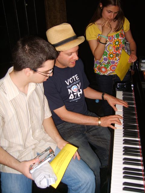 Eli with students at the piano.