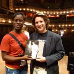 Eli receives book on Mississippi music from teacher at Institute.  That's Elvis Presley and B.B. King on the cover of the book!