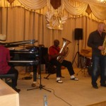 Alex, the jazz instructor at Abakan Music School performs with Eli Yamin Blues Band at workshop.