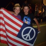 Eli Yamin with Sergey and the flag he waved at concert in Abakan, Siberia