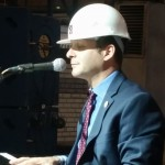 Eli sings the blues with his hard hat on.