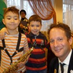 Eli and the youngest saxophonists.