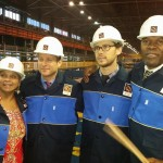 Eli Yamin Blues Band in factory uniforms.