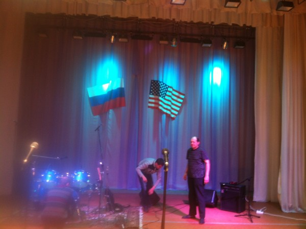Russian and U.S. Flag over stage in Nevyansk