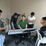 Eli works with piano players at Innato.
